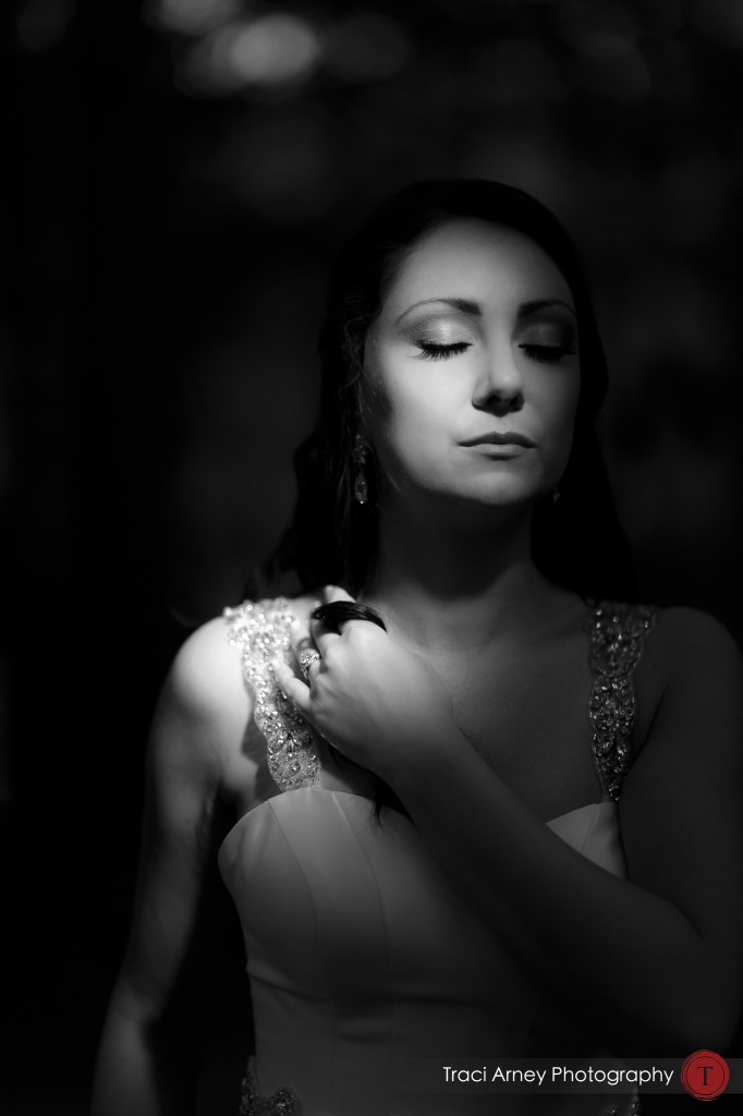 black and white of bride with eyes closed and stream of sunlight on her face